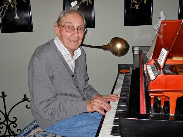 Don playing the same piano that he played when he was fourteen years old. His father was a concert pianist.
