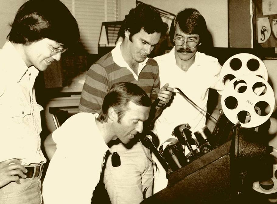 Andy Gaskill, Don Bluth, John Pomeroy and Gary Goldman review tests on the Moviola at Disney during Pete's Dragon. (photo via)