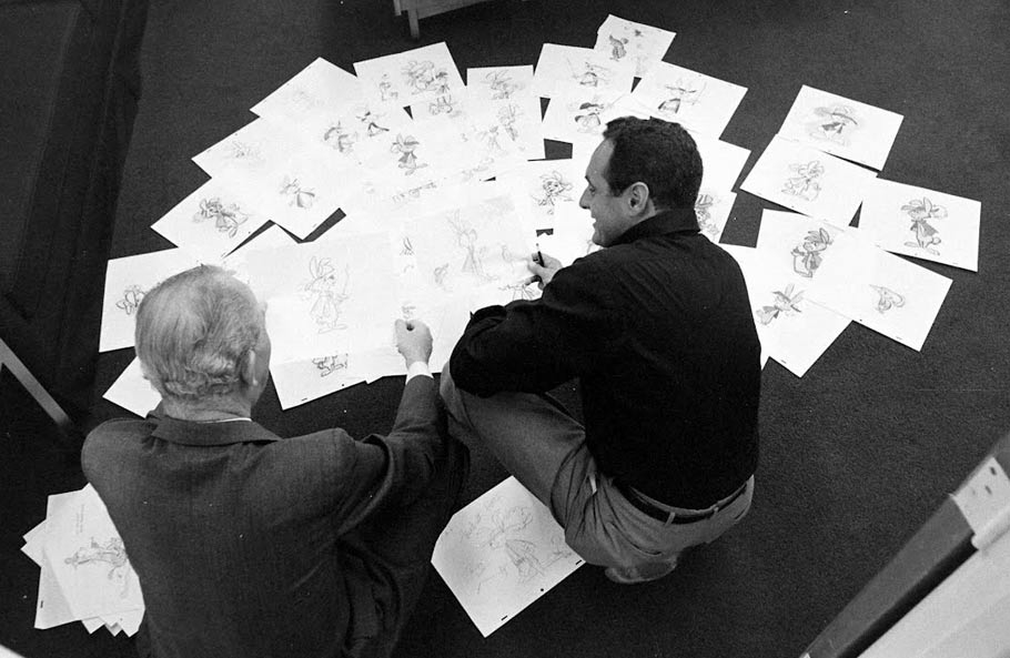 Joe Barbera (right) reviewing concepts for Touché Turtle, most of which appear to have been drawn by Ed Benedict.