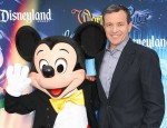 Bob Iger and Mickey Mouse. (Photo via Shutterstock.)
