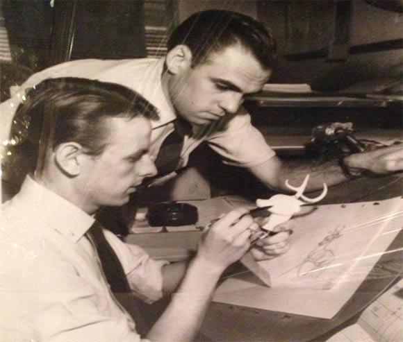 "Willis Pyle (seated) working on Disney's ""Bambi."""