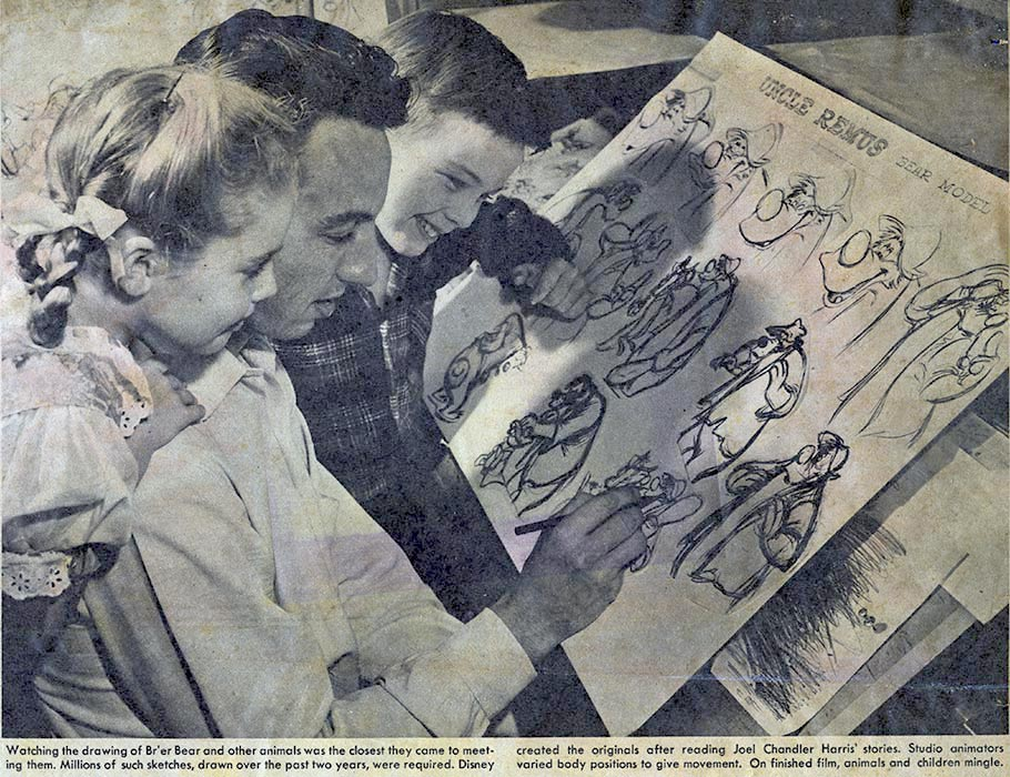 "Clarke Mallery gives a drawing lesson to ""Song of the South"" child stars Luana Patten and Bobby Driscoll."