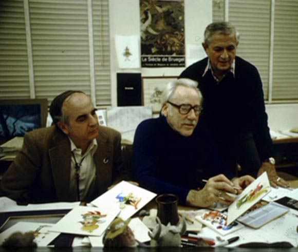"Producer Joe Hale, left, clashed with Jeffrey Katzenberg over creative choices in ""The Black Cauldron."" Hale is discusing the film with one of the original co-directors, Art Stevens  (center), and co-director Ted Berman."