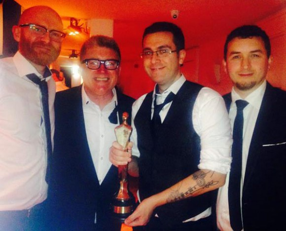 Celebrating their win (l. to r.): Song of the Sea producer Paul Young, unidentified, director Tomm Moore, writer Will Collins.