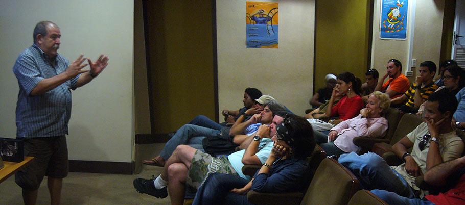 Cuban animation veteran Juan Padrón lectures to young artists.