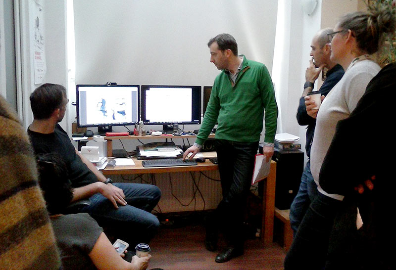 Dan Panaitescu and Dragos Stefan from DSG Studio show some recent work to a group of festival visitors. (Photo by Tess Martin.)