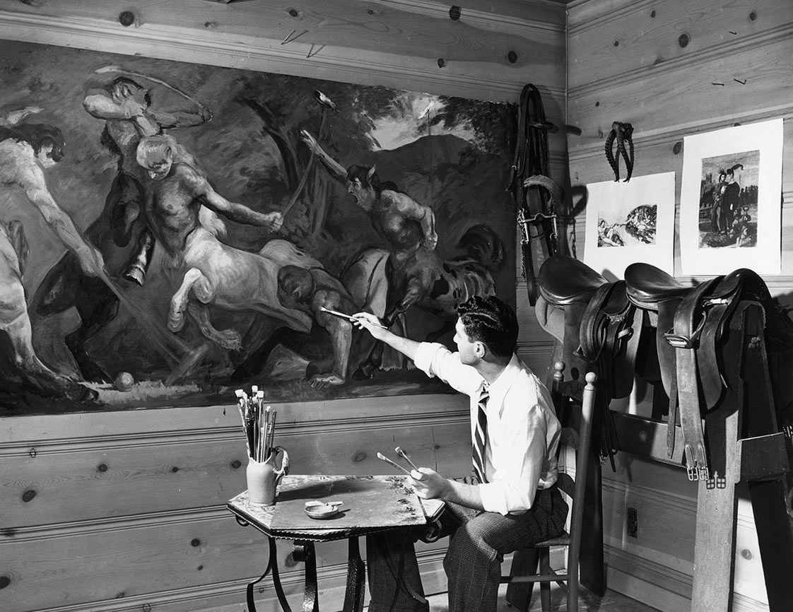 "Mel Shaw painting ""The Centaurs"" in the tack room of the Encino Ranch, 1938. (Photo: Rick and Janet Shaw and Melissa Couch.)"