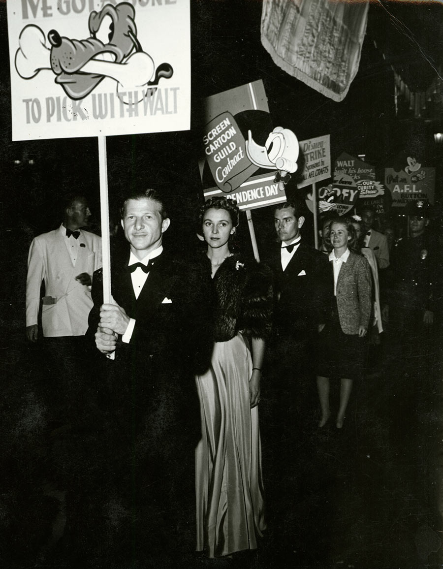 """Animator Art Babbitt, one of the strike leaders, leads a picket at the premiere of """"The Reluctant Dragon."""""""