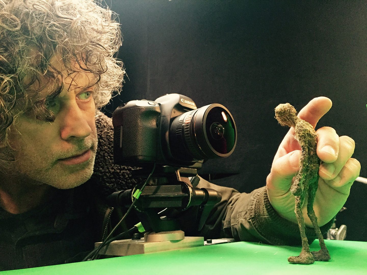 A Tippett Studio employee photographing a creature for Hologrid.
