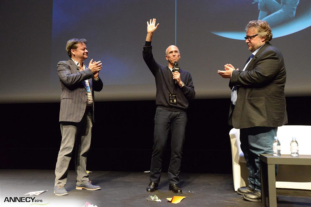 Annecy's artistic director Marcel Jean with Jeffrey Katzenberg, who was presented with a lifetime pass to the festival, and director Guillermo del Toro. (Photo: D. Bouchet/CITIA)