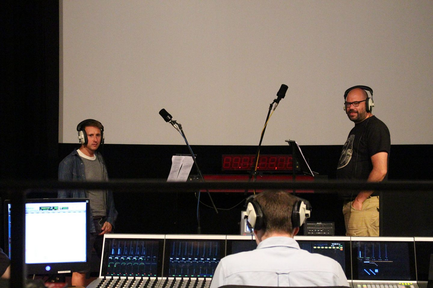 Voice actors Peter Caulfield (left) and Tom Davis during a recording session.