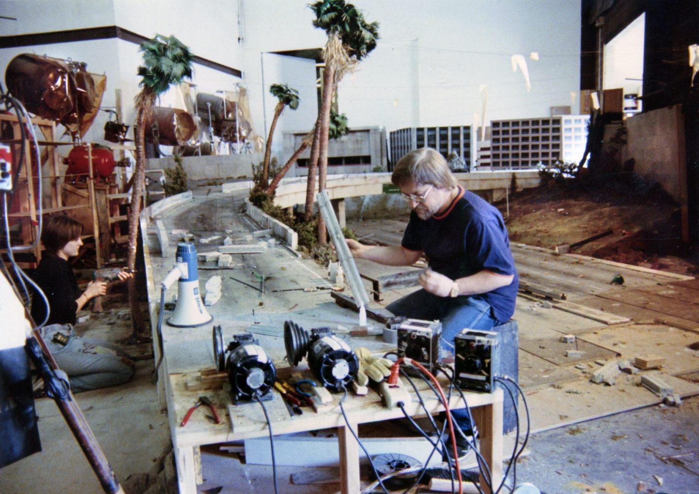 Dennis Skotak (foreground) works on the LA miniature, with Samantha Stevens at left.