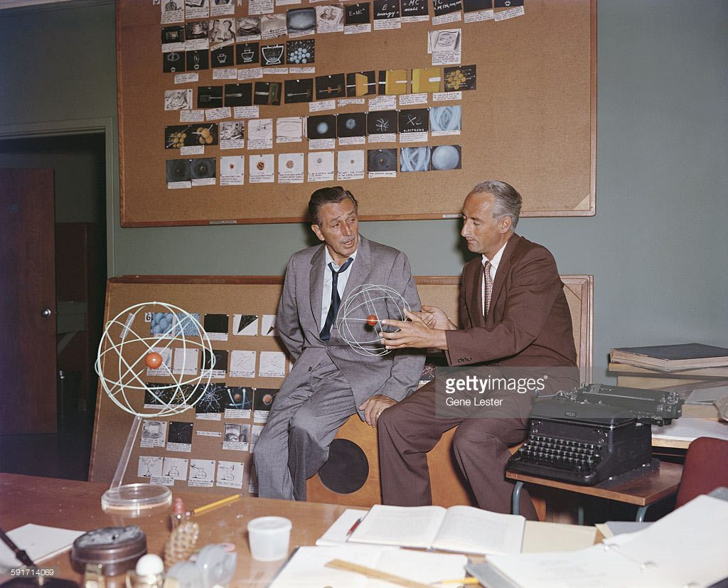 "Walt Disney discussing the ""Disneyland"" space specials with one of the presenters, ex-Nazi Heinz Haber."