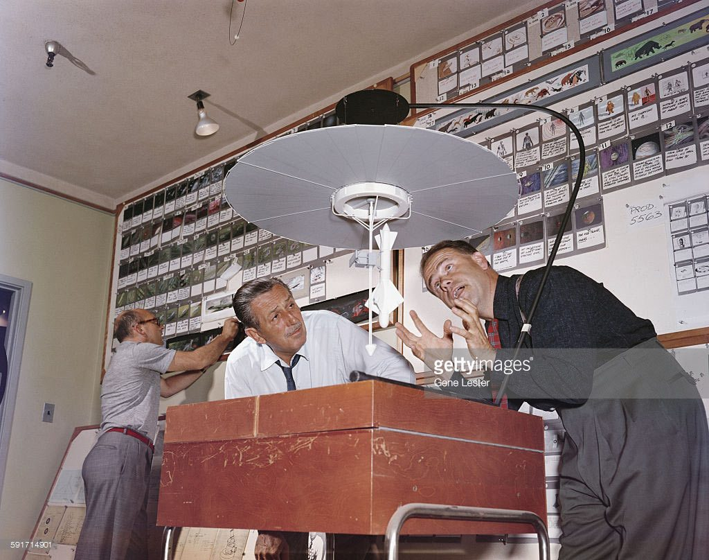 "Walt Disney and Ward Kimball working on the ""Disneyland"" TV space specials. Bill Bosche in the background."
