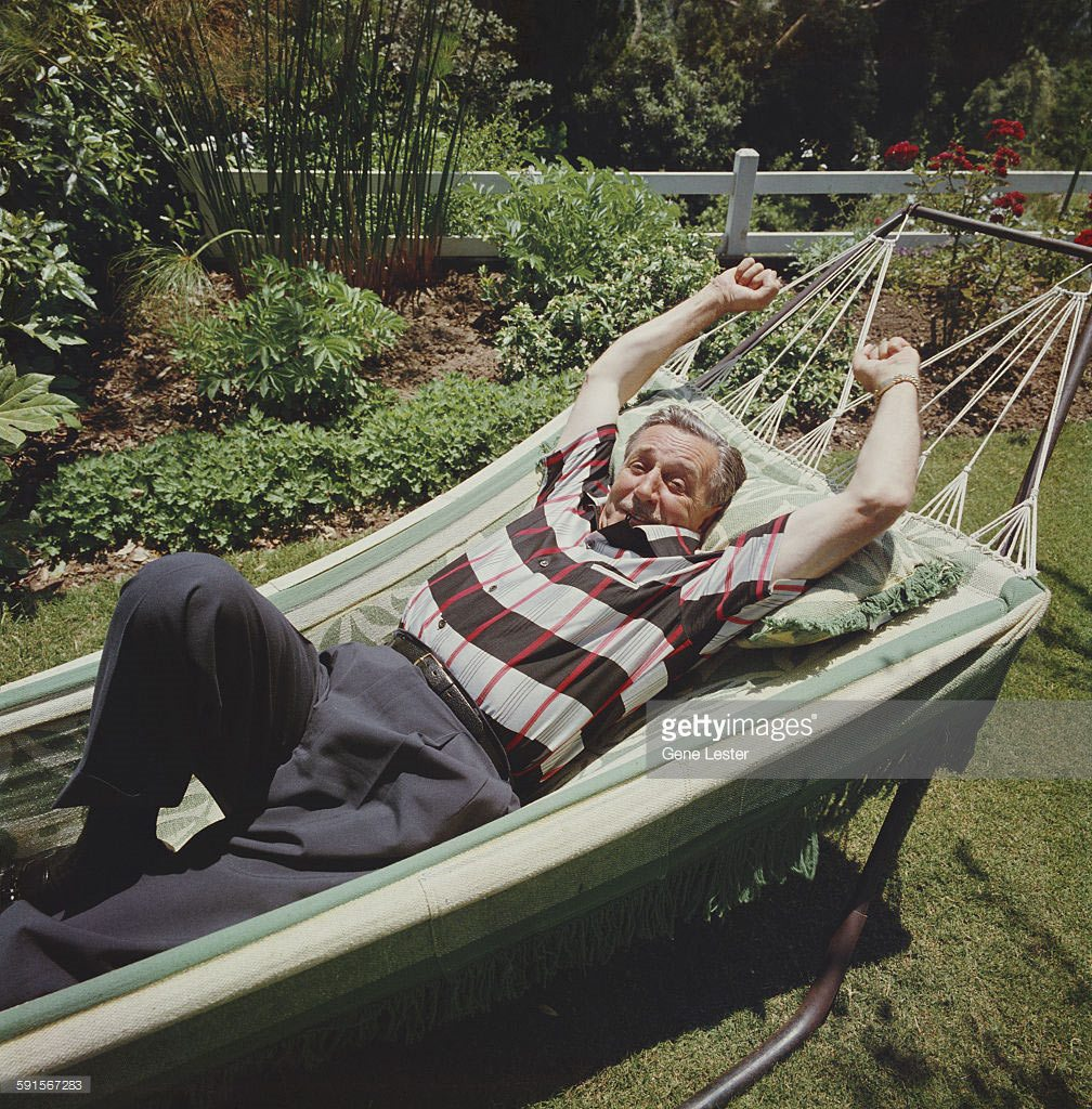 Walt Disney relaxing at home.