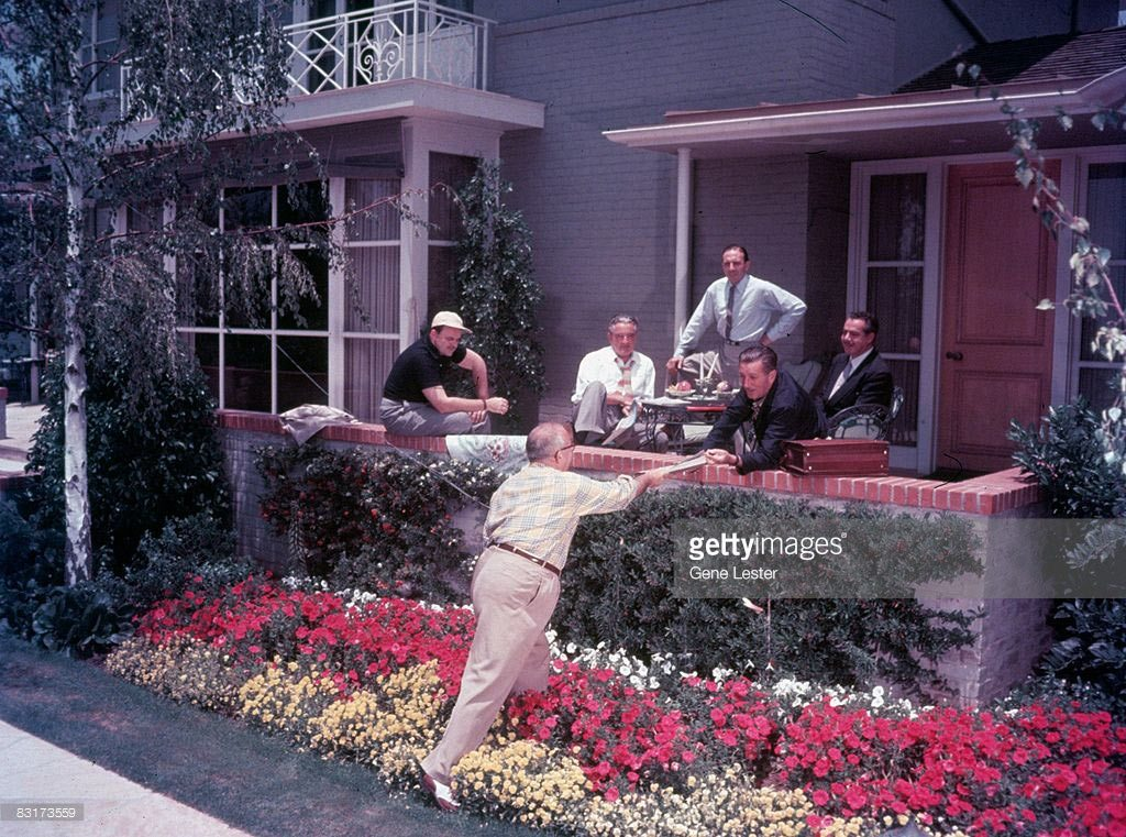 Walt Disney in a meeting at his home.