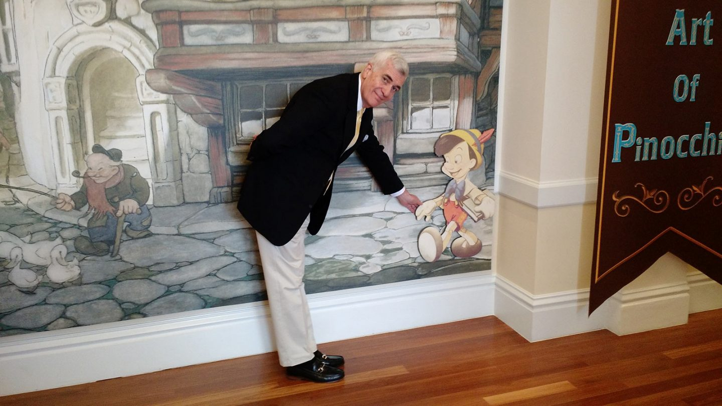 John Canemaker greets Pinocchio at the Walt Disney Family Museum.