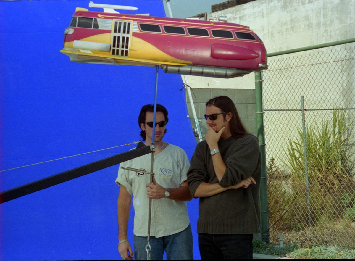 Members of Vision Crew Unlimited shoot a miniature spacecraft.