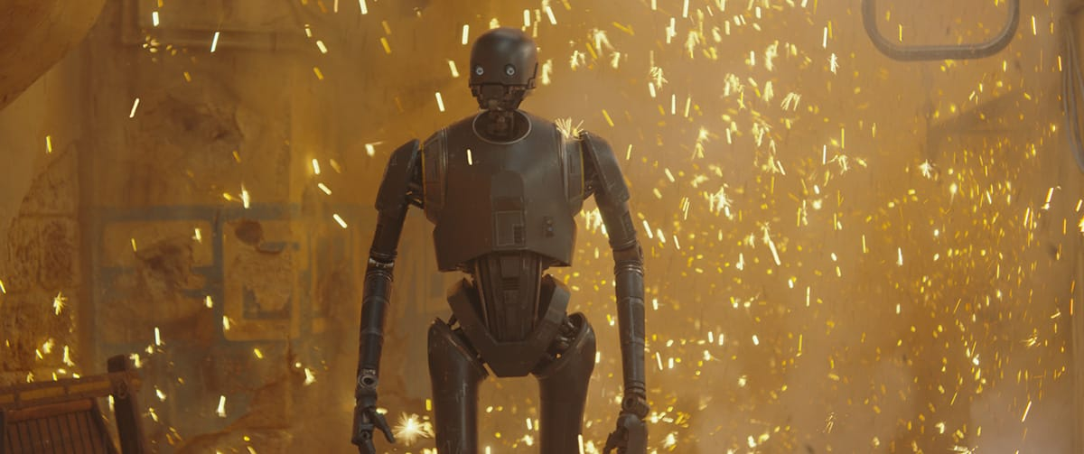K-2 features in this scene where he nonchalantly dispatches a group of troopers with a live grenade.