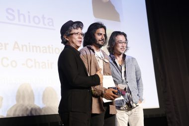 Ishan Shukla (center) receiving Best in Show at SIGGRAPH Asia 2016. Image courtesy SIGGRAPH Asia.