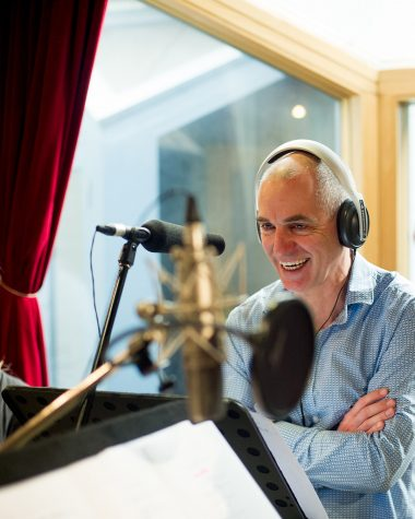 Rob Sitch during a voice recording session. Photo credit: Hwa Goh. Image © Pacific Heat TV Pty Ltd.