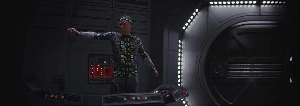 Alan Tudyk performs in a capture suit on set.
