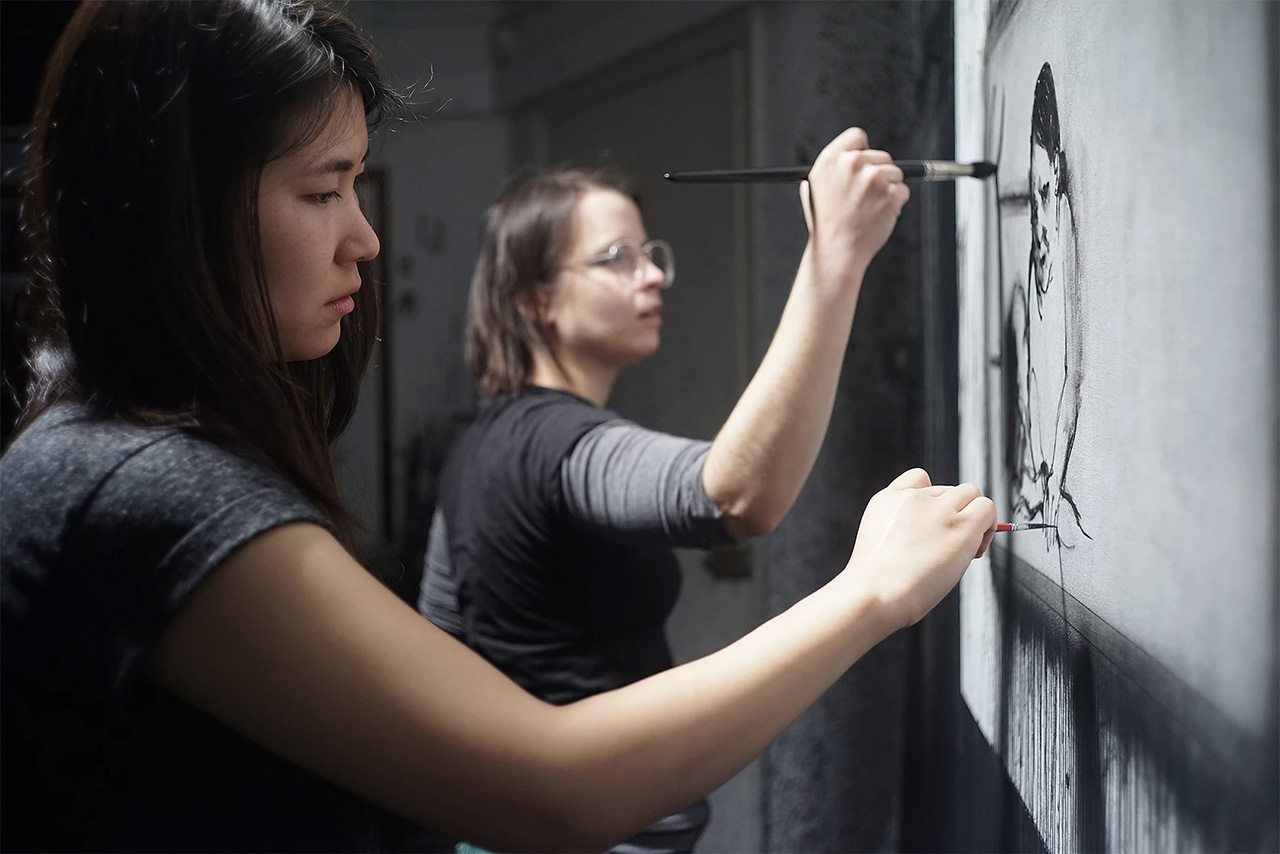 Minha Kim (l.) and assistant working on film.