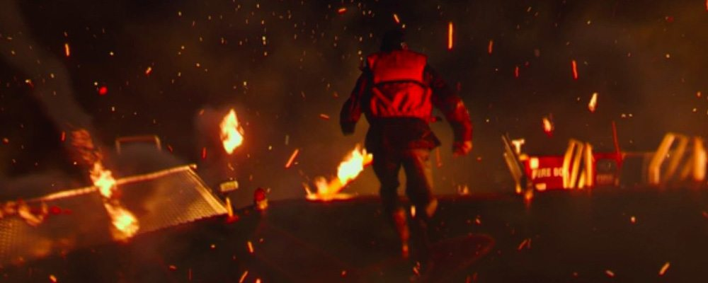 In the first of three screenshots from the trailer for Deepwater Horizon, Mike Williams (Mark Wahlberg) makes a leap for safety from the burning platform.