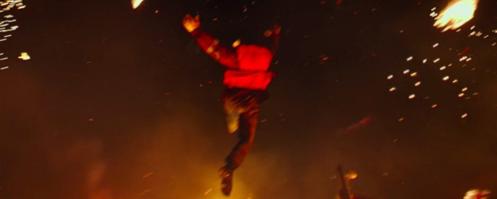 A real stunt was filmed of the leap, but ILM extensively added fire and water elements.