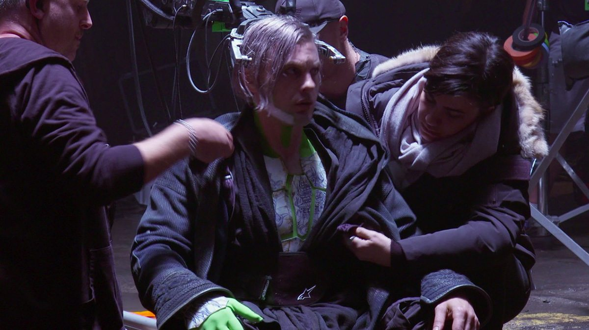 Michael Pitt on set in prosthetics and covered in greenscreen material pieces (screenshot from production b-roll).