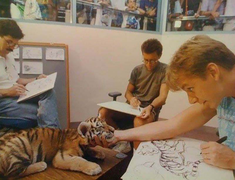 "Aaron Blaise (right) drawing a tiger cub during the production of Disney's ""Aladdin."""