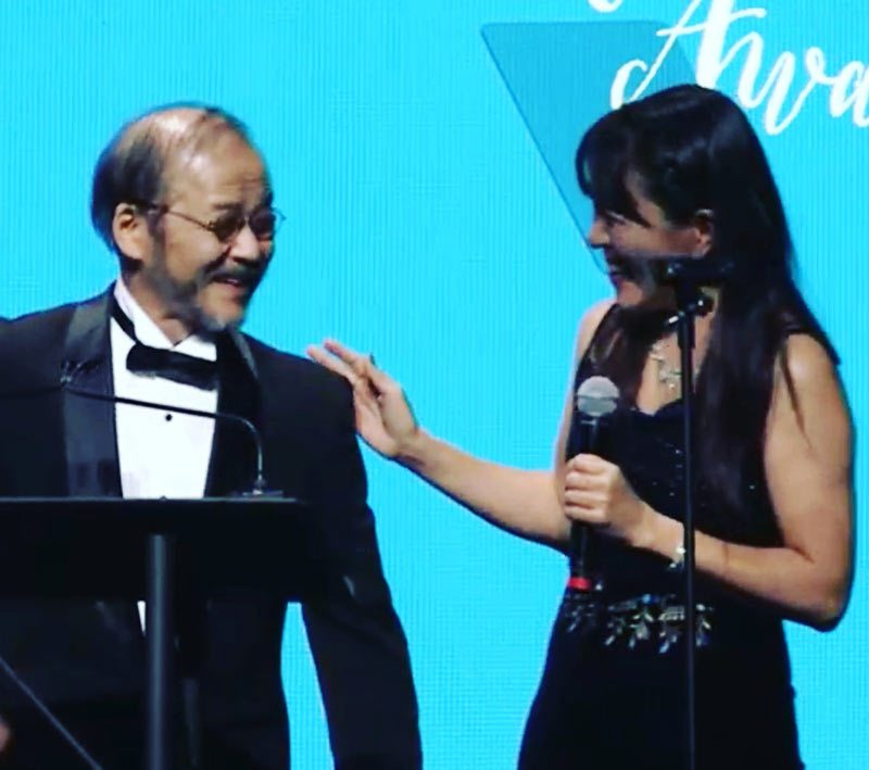 Maki Terashima-Furuta with Mamoru Oshii at the 2017 Annie Awards.