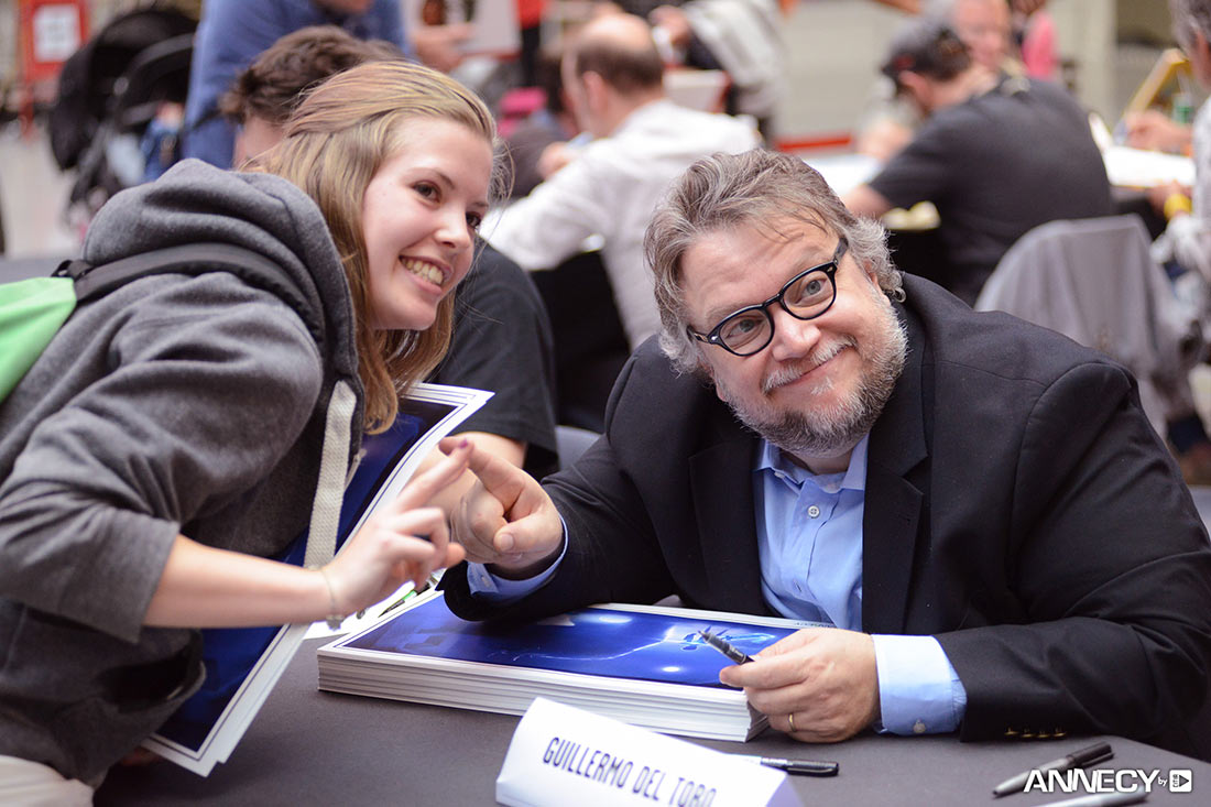 Guillermo del Toro meets a fan at a signing session.