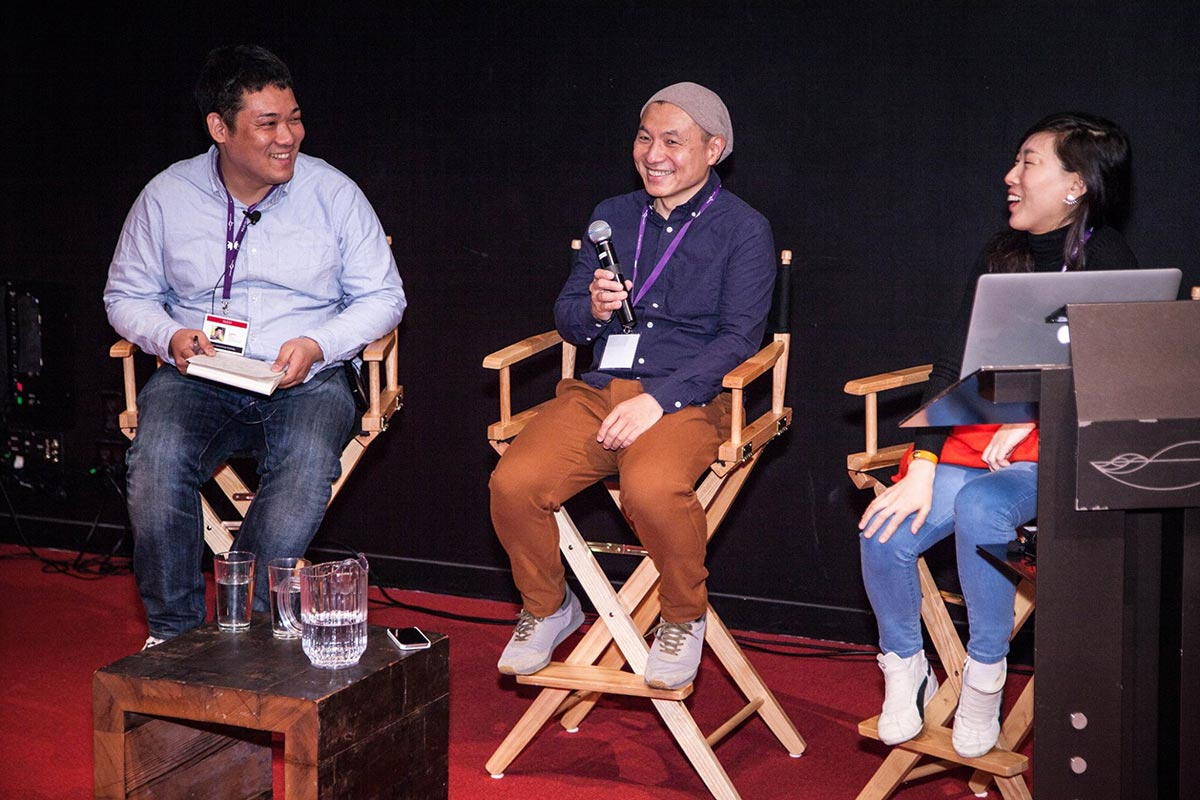 Moderator Nobuaki Doi (l.) speaks with Science Saru founders Masaaki Yuasa and Eunyoung Choi.