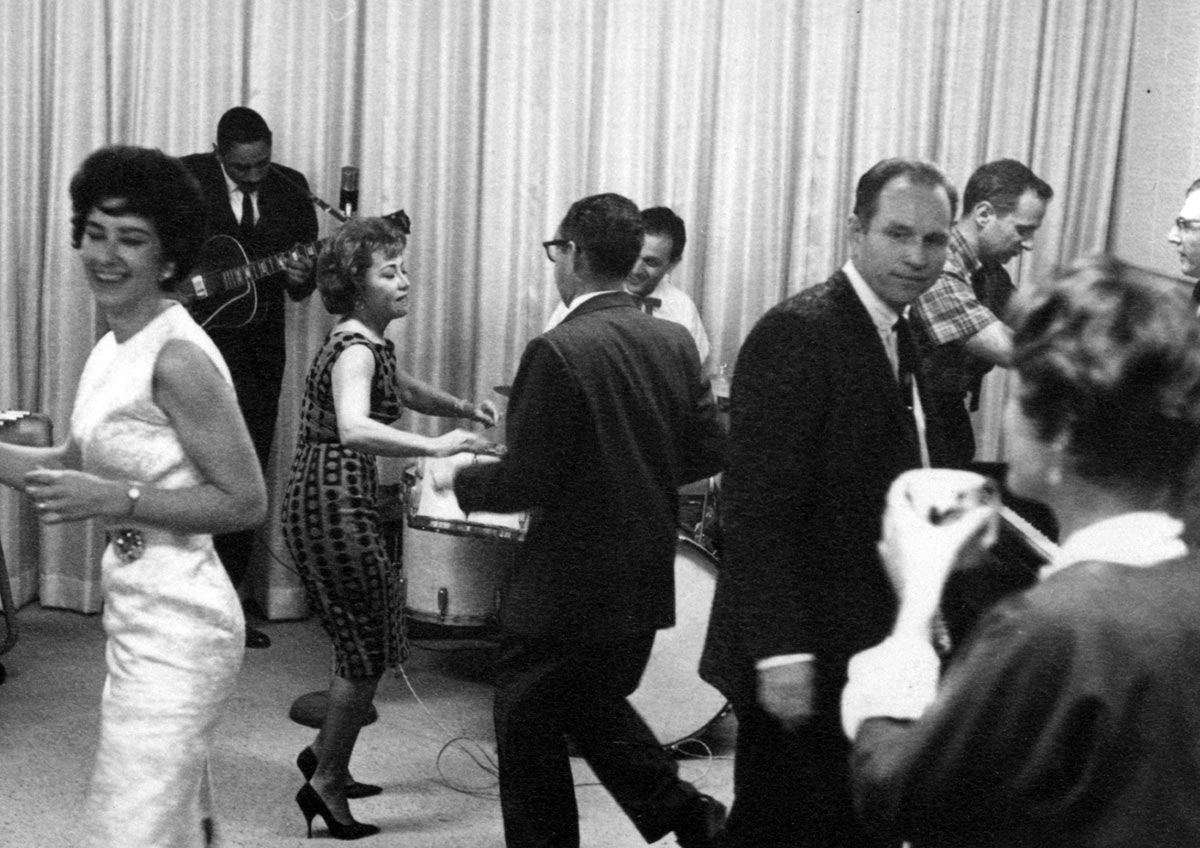 June Foray dancing (center) at a Format Films holiday party, ca. early-1960s.