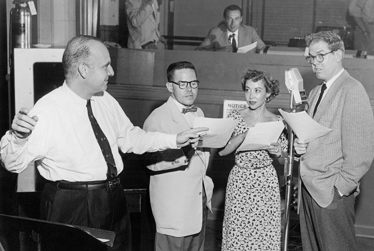 "June Foray recording ""St. George and the Dragonet"" with, from left, Walter Schumann, Daws Butler, and Stan Freberg, 1953."