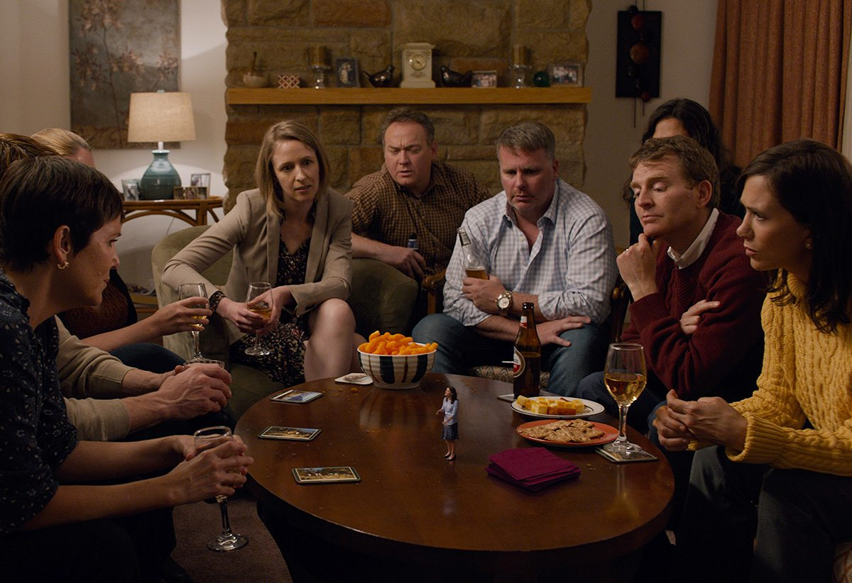 A classic scale shot in Downsizing features normal sized characters interacting with shrunken down characters 1/14th in size.