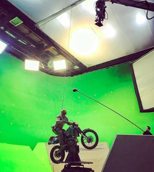 Dwayne Johnson posted this behind the scenes pic of the motion base motorcycle shoot on his Instagram account.