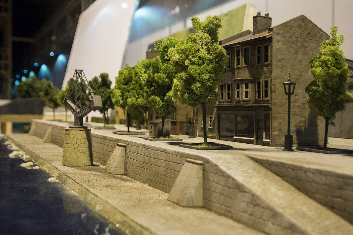 Miniature models are also used to represent pre-war cities and towns.