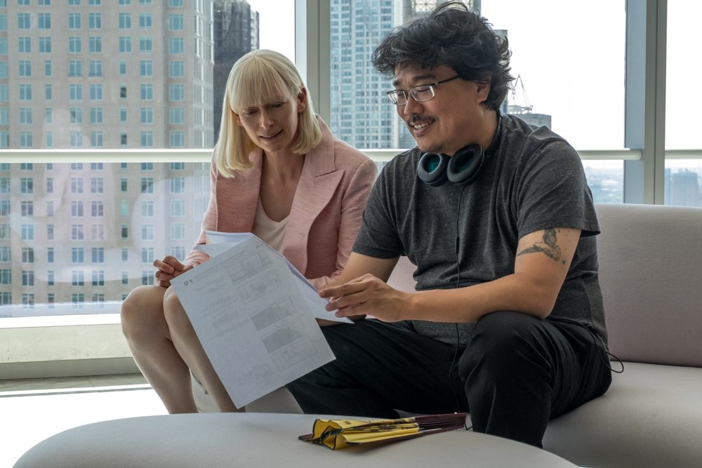 Director Bong Joon-ho with actress Tilda Swinton during the making of Okja.