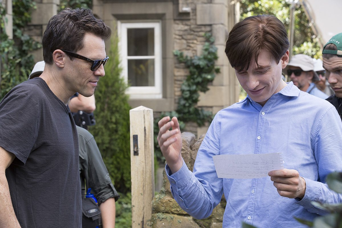"Director Will Gluck (left) with Domhnall Gleeson on the set of ""Peter Rabbit."""