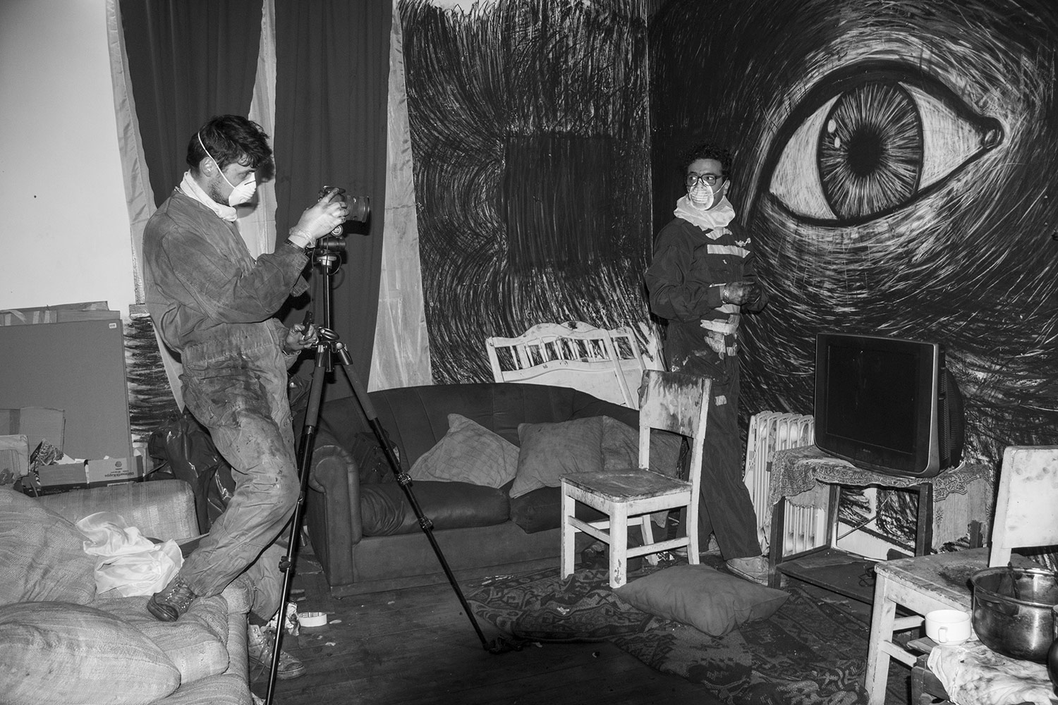 The filmmakers animating and filming on set.