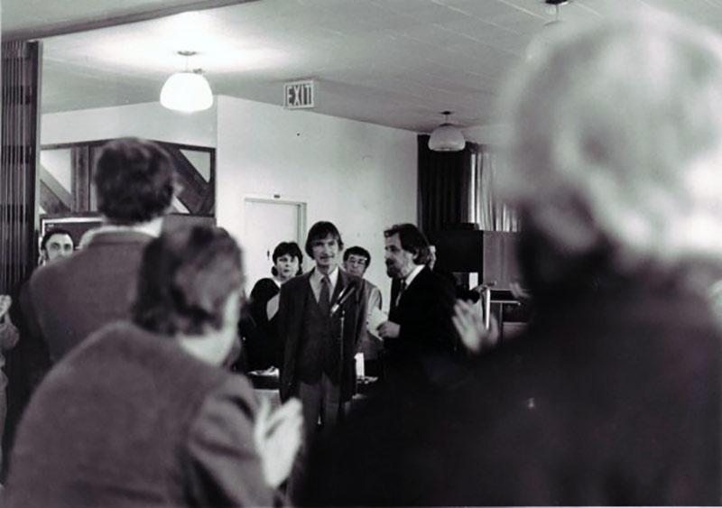 Norman McLaren's retirement party in 1983 in the NFB cafeteria. Hélène Tanguay is standing left of McLaren.