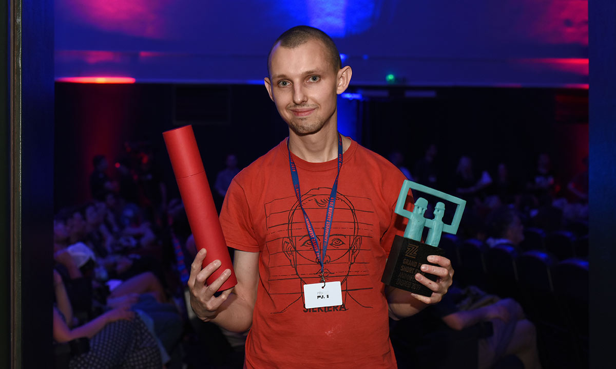 "Tomek Popakul accepting his Grand Prix and audience award for ""Acid Rain."" Photo courtesy Animafest Zagreb."