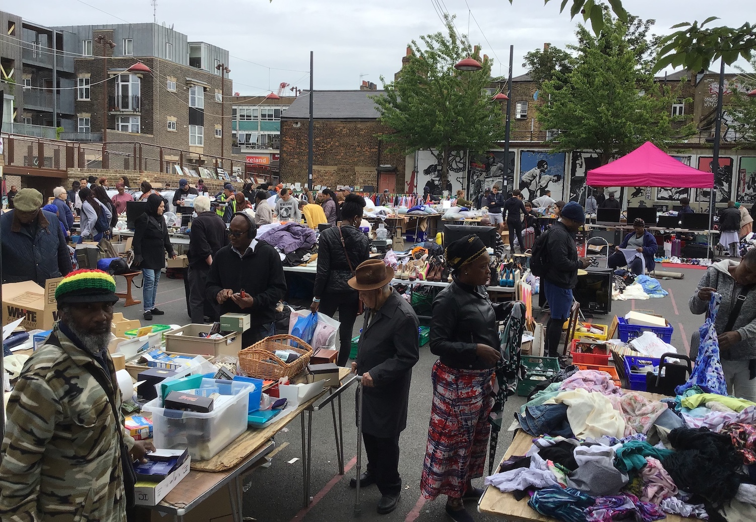 Clothes, books, and bric-a-brac onsale at Deptford Market.
