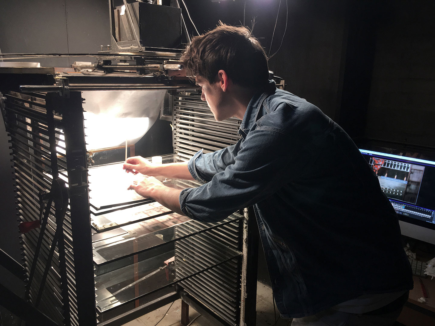 Filmmaker Ollie Magee at work on the multiplane.